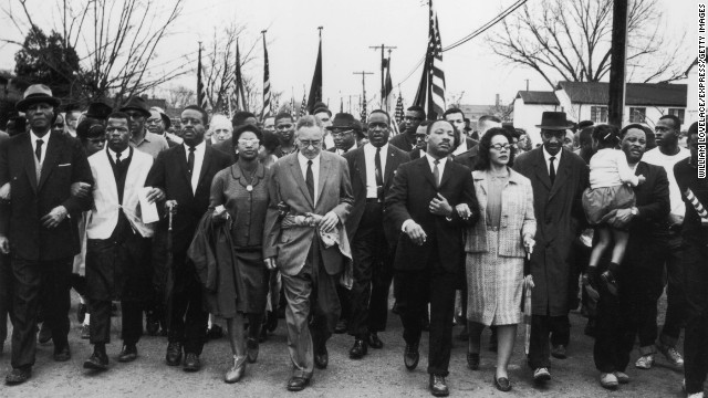 Martin Luther King Jr. and his wife Coretta Scott King lead a voting rights march from Selma to Montgomery, Alabama, in March 1965.