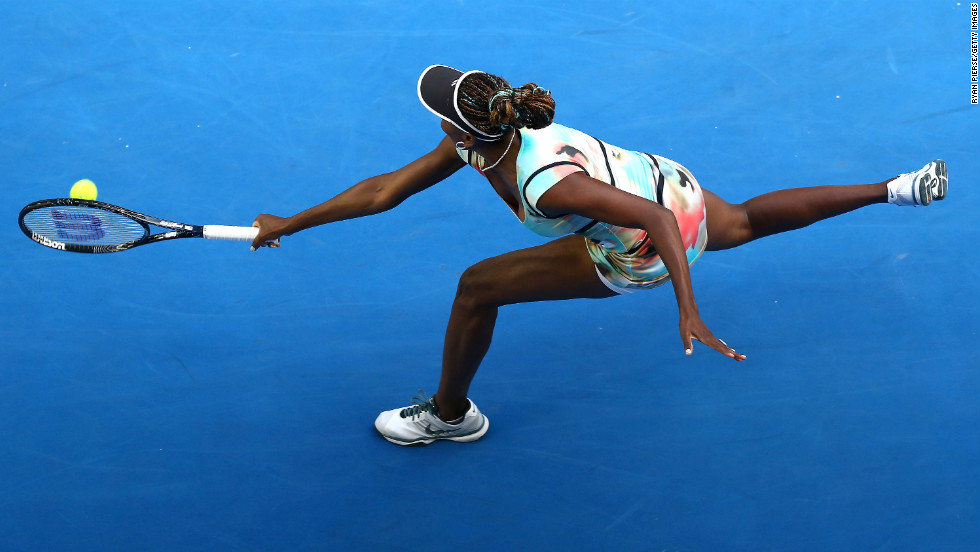 Williams plays a backhand in her third-round match against Sharapova on January 18.