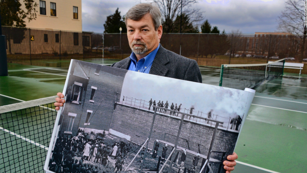"Michael W. Kauffman is author of ""American Brutus: John Wilkes Booth and the Lincoln Conspiracies."" Here he stands on a tennis court at Fort McNair, the site of the Lincoln conspirators' hanging."