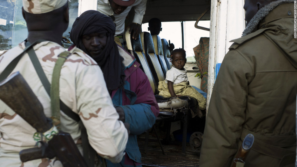 Malian soldiers man a checkpoint in Niono on January 18.