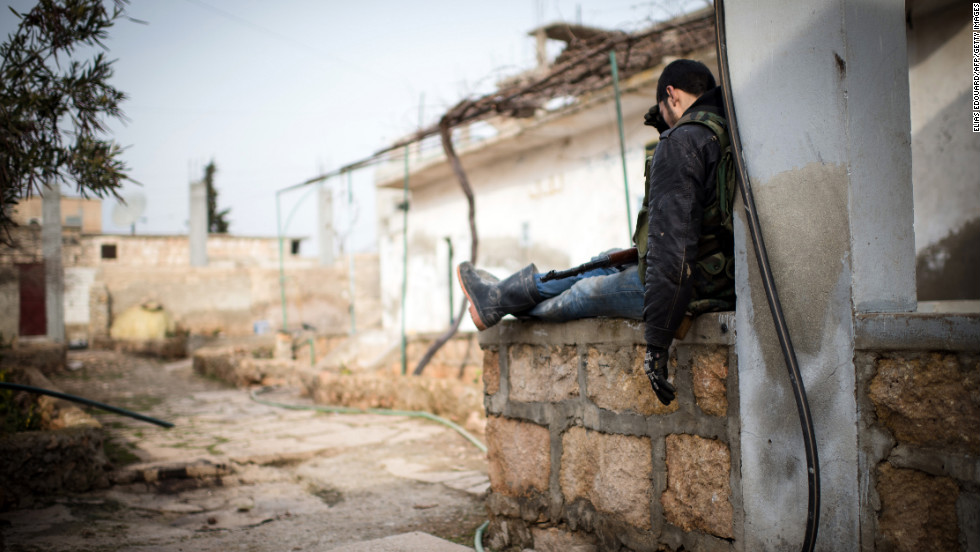 An anti-regime fighter rests in a rebel controlled area of Aleppo on January 18.