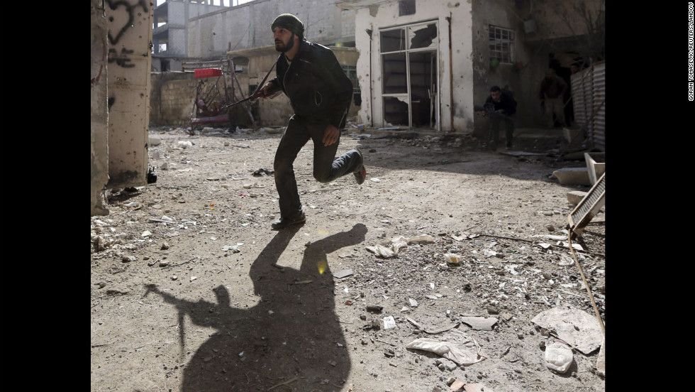 A rebel fighter runs for cover in Damascus on January 19.