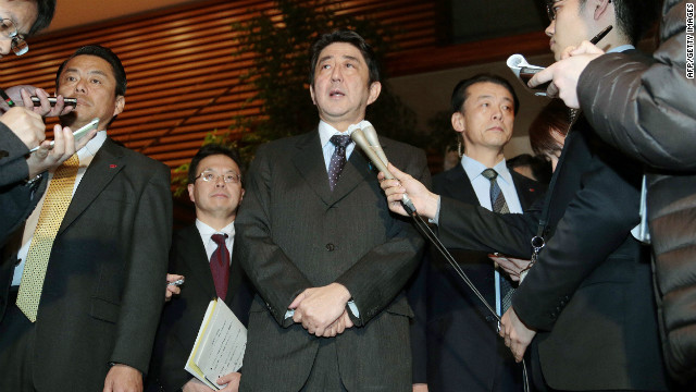 Japanese Prime Minister Shinzo Abe speaks to reporters in Tokyo after a telephone conversation with Algerian counterpart Abdelmalek Sellal Sunday.