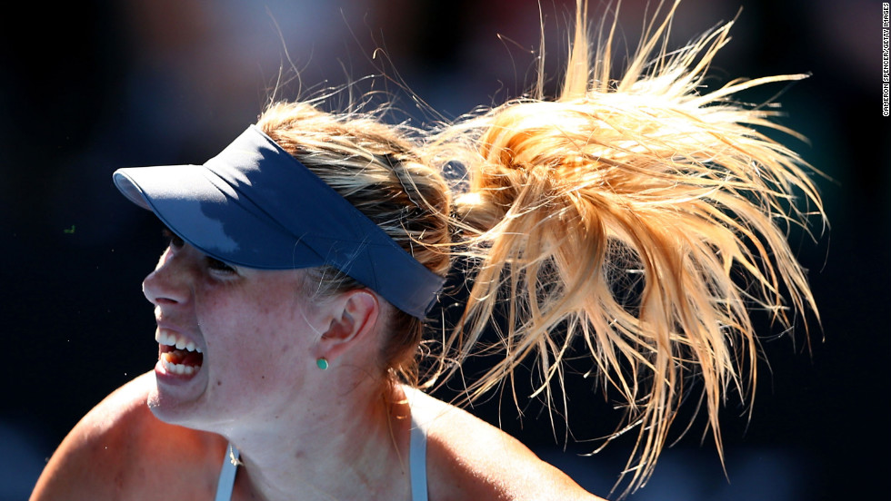 Sharapova serves in her fourth-round match against Flipkens.