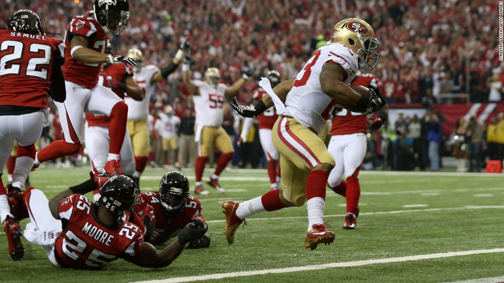 LaMichael James of the San Francisco 49ers scores a 15-yard rushing touchdown in the second quarter.