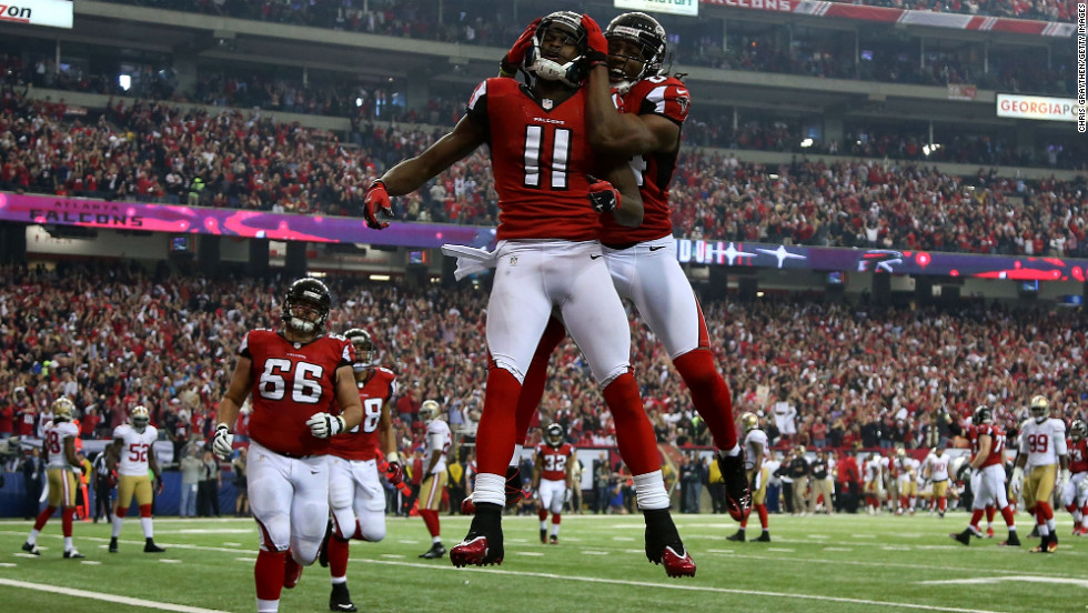 Julio Jones, left, and Roddy White of the Atlanta Falcons jump in the air to celebrate after Jones caught a 20-yard touchdown in the second quarter.
