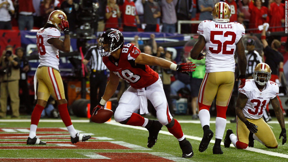 Tony Gonzalez of the Atlanta Falcons catches a 10-yard touchdown against the San Francisco 49ers on Sunday.