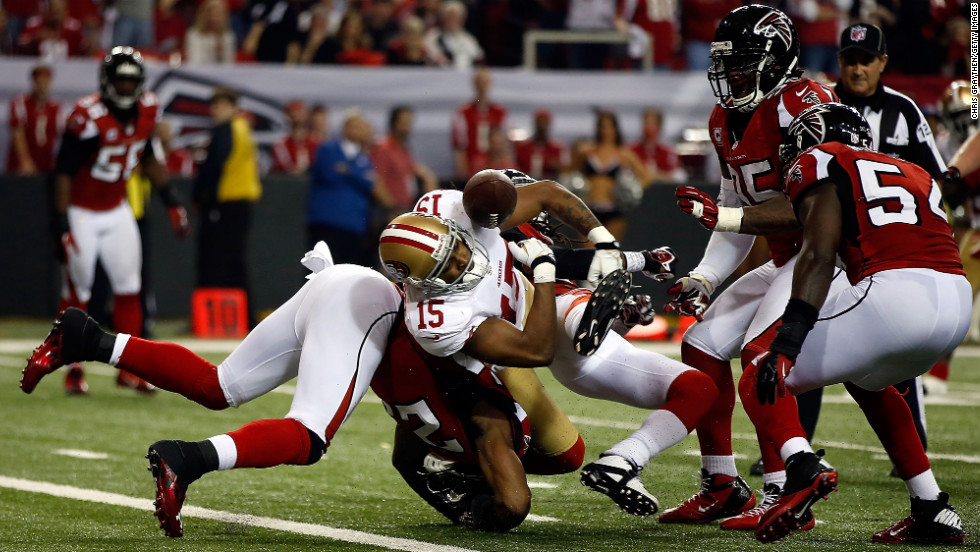 Michael Crabtree of the San Francisco 49ers fumbles the football against the Atlanta Falcons. The ball was recovered by No. 54 Stephen Nicholas of the Falcons on the Atlanta 1 yard line.