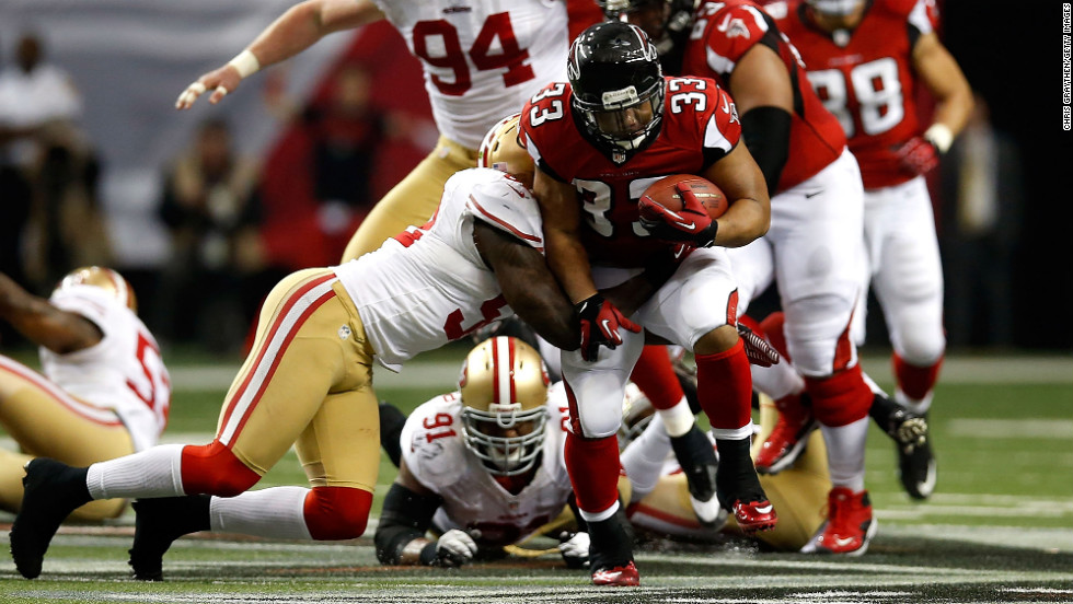 Michael Turner of the Atlanta Falcons runs the ball against the San Francisco 49ers.