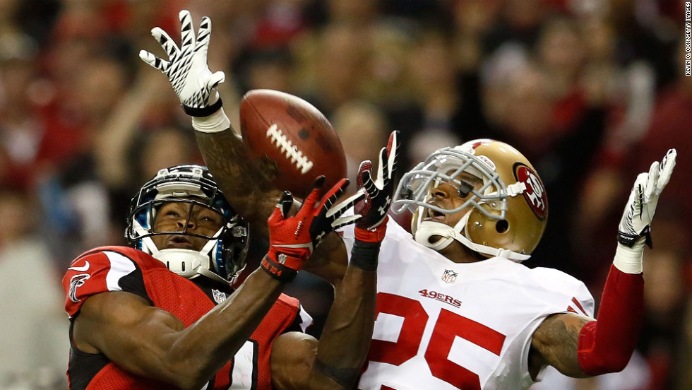 Tarell Brown of the San Francisco 49ers breaks up a pass intended for Julio Jones of the Atlanta Falcons.