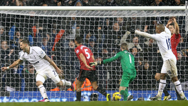 Clint Dempsey (far left) wheels away after grabbing an injury time equaliser for Tottenham against Manchester United