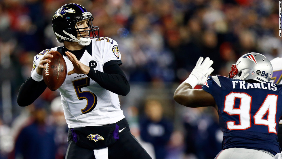 Ravens quarterback Joe Flacco gets pressured by Justin Francis of the New England Patriots.
