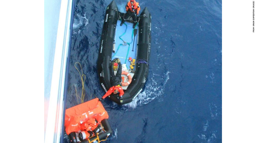A rescue boat from cruise ship Orion reaches Alain Delord's life raft  on Sunday.