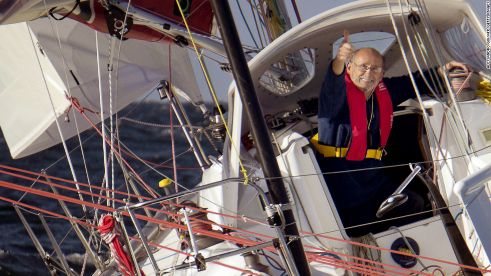 Alain Delord onboard his yacht named 'Tchouk Tchouk Nougat' as he leaves the harbor of Crouesty in western France for a solo round-the-world tour on October 27.
