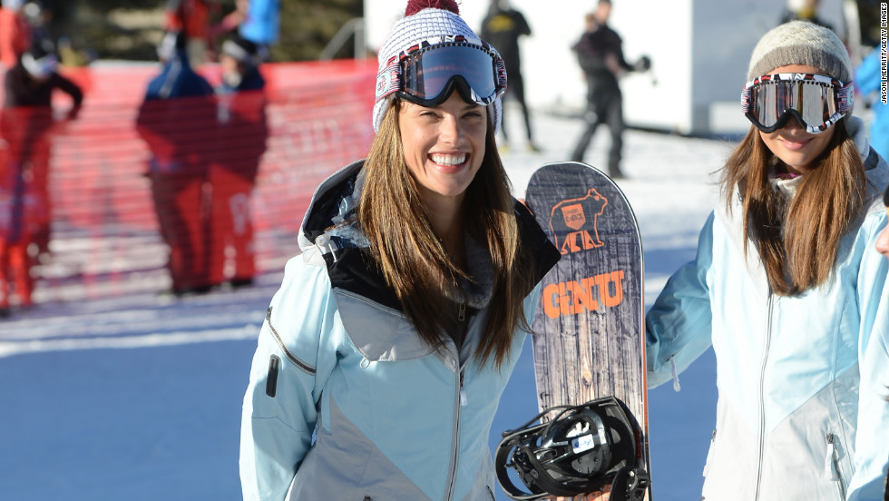 Alessandra Ambrosio goes snowboarding.