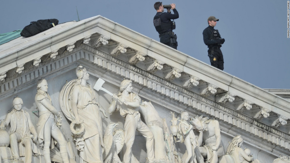 The U.S. Capitol Police stand guard Monday atop the Capitol.