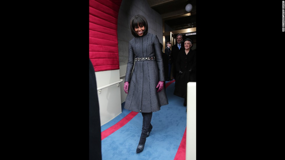 "For Inauguration Day in 2013, the first lady mixed ""high"" and ""low"" fashion with a belt from J. Crew, a coat and dress by Thom Browne, Reed Krakoff boots and a necklace by Cathy Waterman, the White House said. After the festivities, the outfit and accessories were to go to the National Archives."