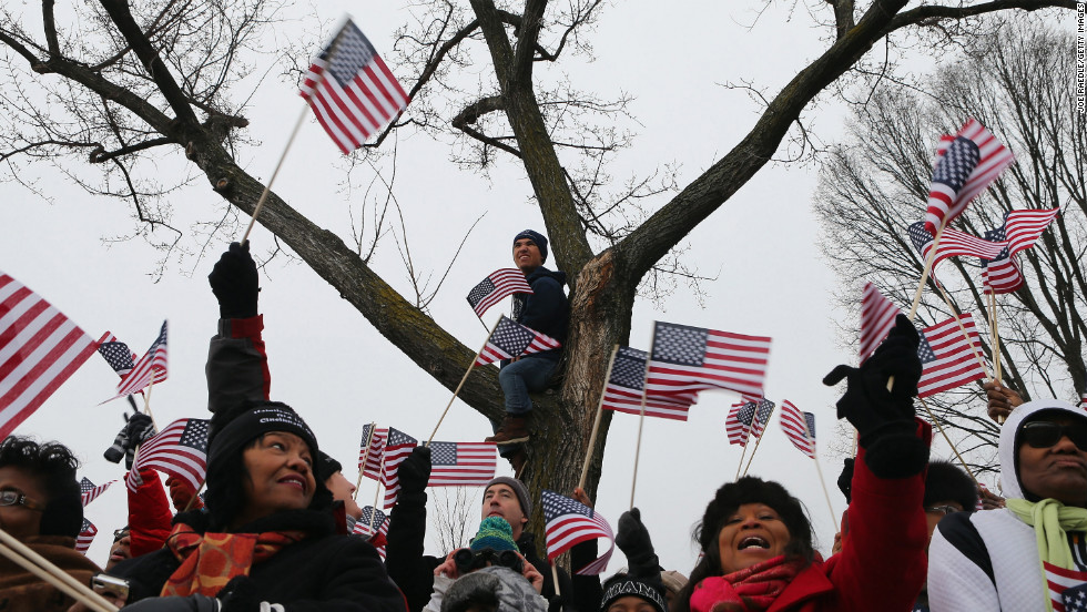 Attendees wave flags at the public ceremonial swearing-in ceremony for Obama on January 21.