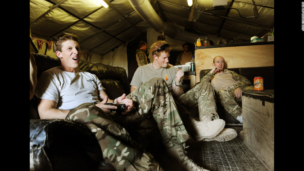 Harry plays video games with fellow pilots Capt. Simon Beattie, left, and Sgt. James John.