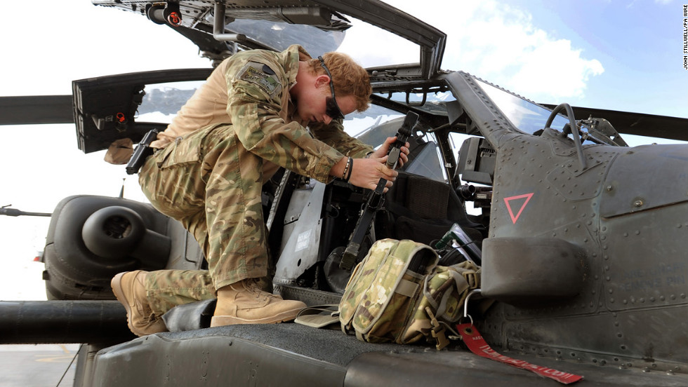 Harry services an Apache helicopter on October 31, 2012.