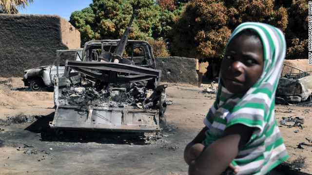 A boy stands by Islamist vehicles destroyed in a French-Malian aerial attack Monday in Diabaly, Mali.
