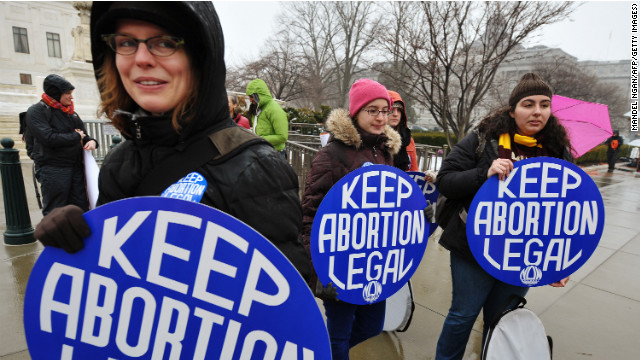 Young women hold placards during a pro-choice rally outside of the Supreme Court in Washington last year.
