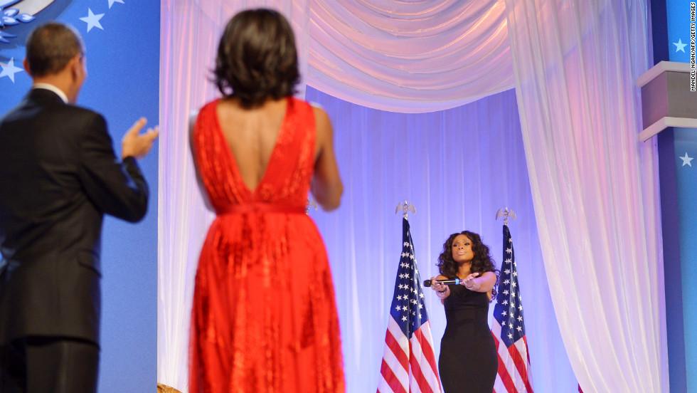 The Obamas applaud singer Jennifer Hudson after their first dance.
