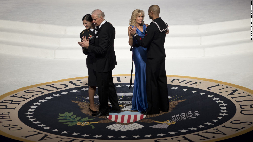 Vice President Joe Biden and wife Jill dance with service members.
