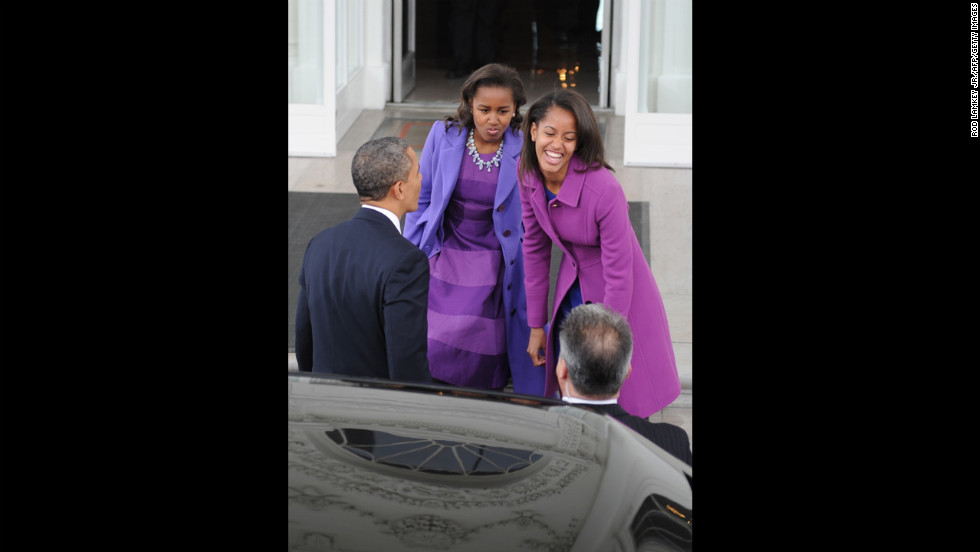 The president and his daughters return to the White House from prayer services at St. John's Episcopal Church on January 21.