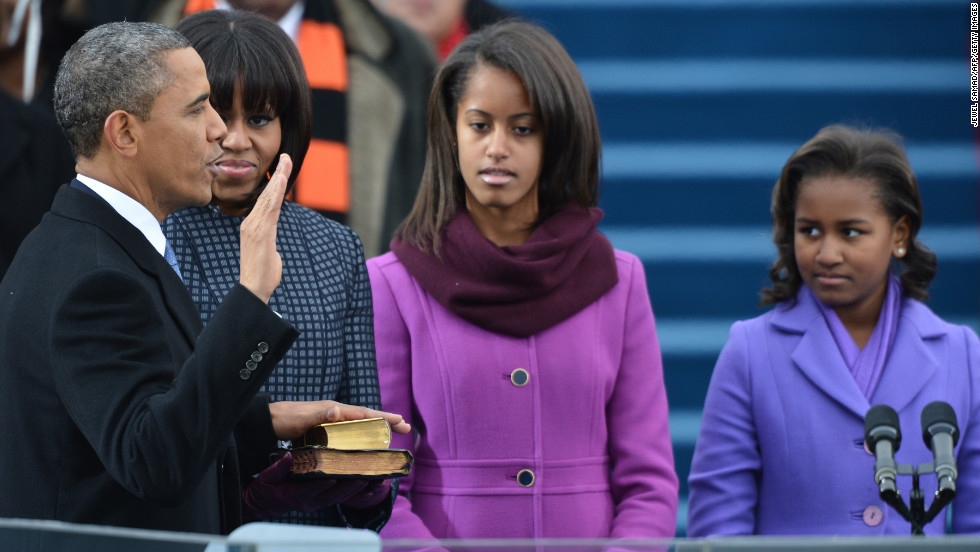 President Obama takes the oath of office while his wife, first lady Michelle Obama, and daughters Malia and Sasha, watch during the 57th Presidential Inauguration ceremonial swearing-in at the U.S. Capitol.
