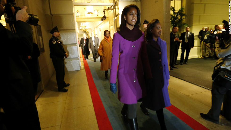 Malia and Sasha are escorted through the corridor to the west door of the U.S. Capitol to begin swearing-in ceremonies on January 21.