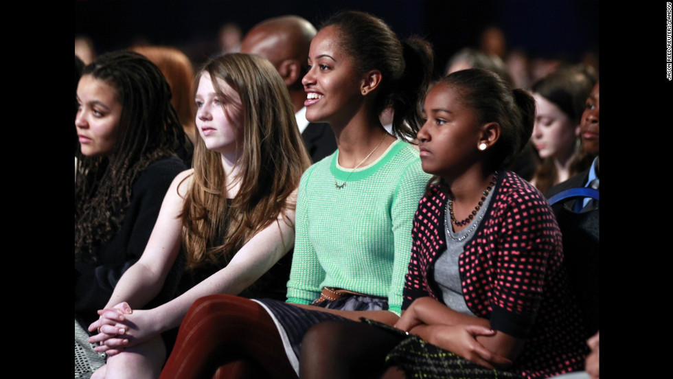 From right, Sasha and Malia watch the Kids' Inaugural Concert on January 19 for children and military families, one of the events ahead of the second-term Inauguration of President Obama.
