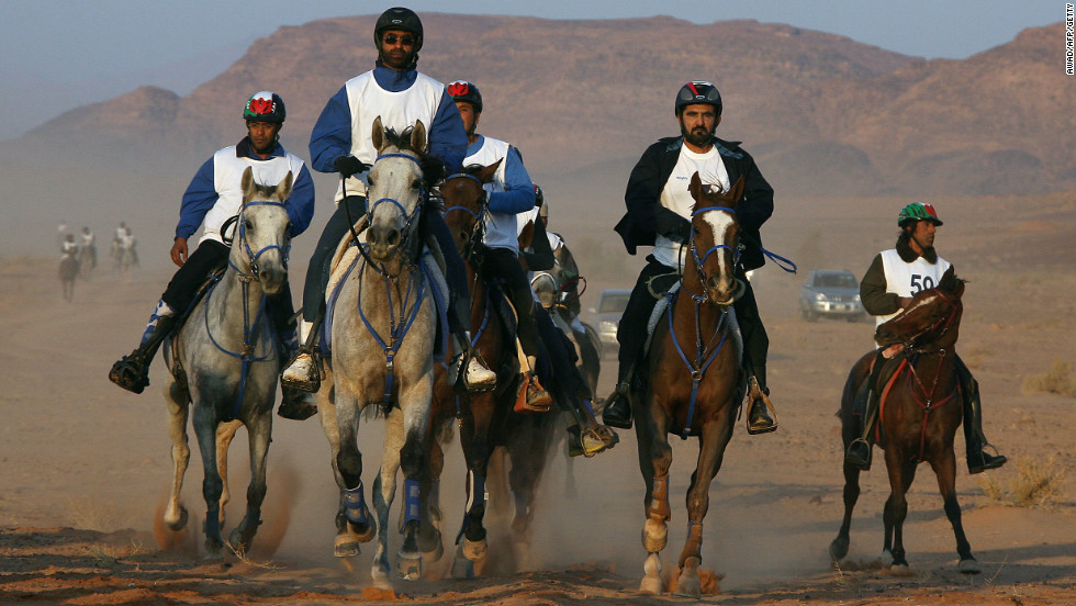 As well as being world champion, Sheikh Mohammed (second right) has won many races on home soil and has a showpiece endurance event named after him -- the Al Maktoum Cup.
