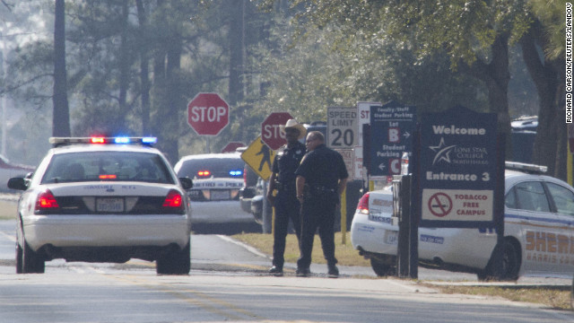 Image #: 20904485    Sheriff Deputies and Houston Police stand on the street to the Lone Star College North Harris campus in Houston, Texas January 22, 2013. A shooting broke out between two people on the campus on Tuesday and there were three injuries, including one of the shooters, police and a school spokesman said. REUTERS/Richard Carson (UNITED STATES - Tags: EDUCATION CRIME LAW)       REUTERS /RICHARD CARSON /LANDOV