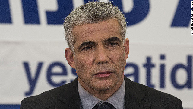 TEL AVIV, ISRAEL - JANUARY 22: Yair Lapid, chairman of 'Yesh Atid' party gives a speech during the celebration of there suggested 19 mandates on January 22, 2013 in Tel Aviv, Israel. Exit polls suggested that current Prime Minister Benjamin Netanyahu will return to office, although he performed worse than expected. (Photo by Ilia Yefimovich/Getty Images)