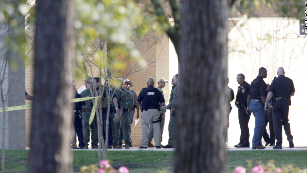 Harris County sheriff's officers work the scene after the January 22 shooting.