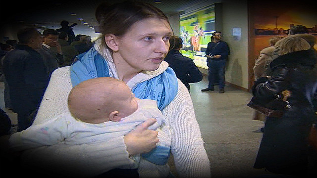 Russians flee Syria, others remain