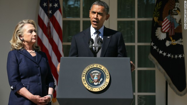 Clinton looks on as President Barack Obama makes a statement in response to the attack at the U.S. Consulate in Libya on September 12, 2012 at the Rose Garden of the White House.