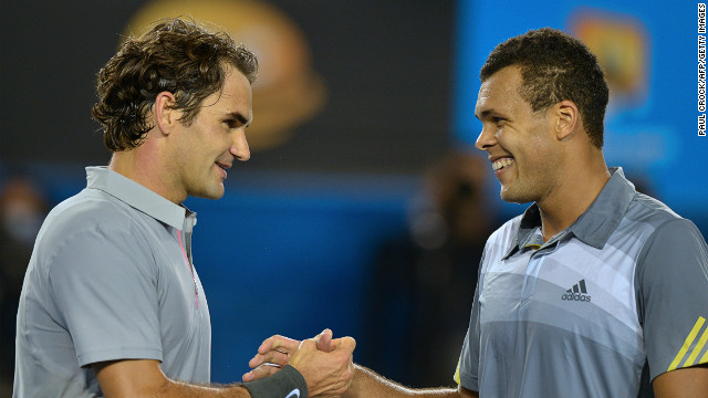 Roger Federer (left) and Jo-Wilfried Tsonga shake hands after their five-set quarterfinal match at the Australian Open.