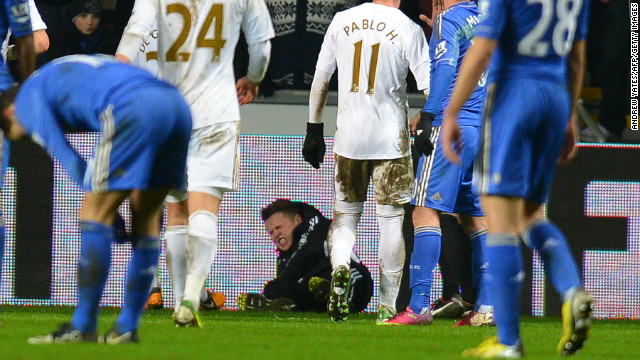 A ball boy grimaces after an altercation with Chelsea midfielder Eden Hazard at The Liberty stadium in Cardiff, January 23, 2013.