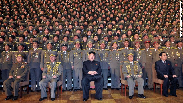 North Korean leader Kim Jong Un poses with security officers in this government-published photograph.