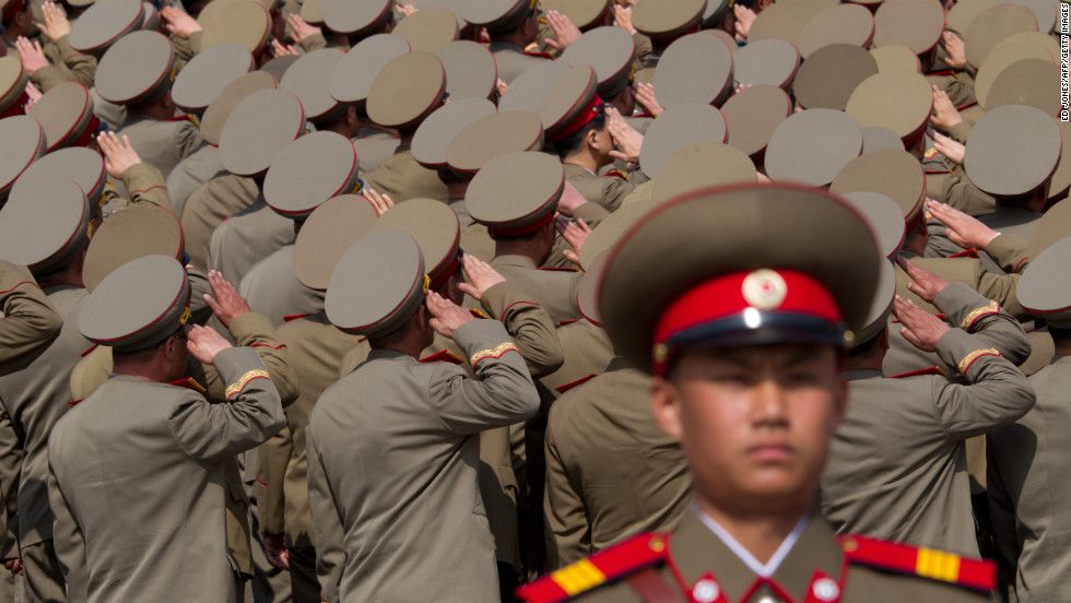 North Korean soldiers salute during a military parade in Pyongyang in April 2012.