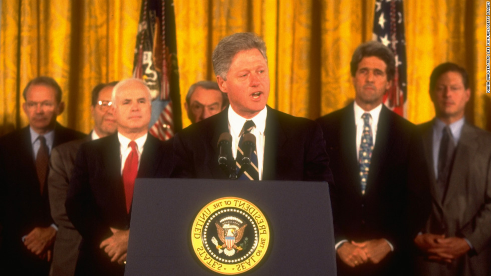 Kerry stands with congressmen and Vice President Al Gore as President Bill Clinton announces his intent to normalize relations with Vietnam in 1995.