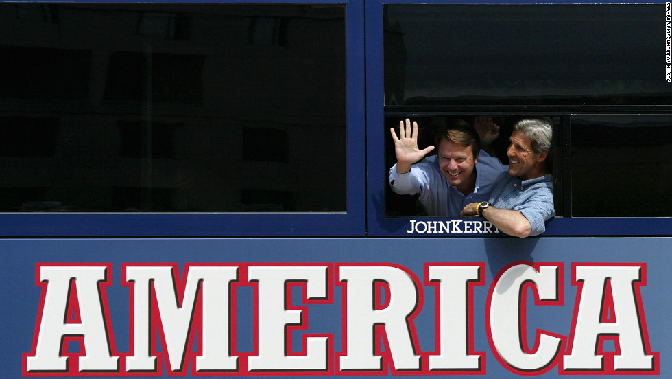 Kerry and running mate John Edwards wave from their bus at a rally stop on July 30, 2004, in Scranton, Pennsylvania.