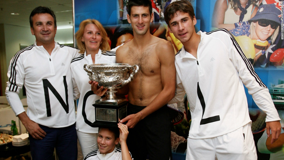 "The Djokovic family celebrate his 2008 Australian Open title in the locker room. Speaking to CNN about his time growing up in Serbia, Djokovic said: ""It was really hard to succeed and I have to thank God for the big support from my father and my mother and all the family. They believed in me ... """