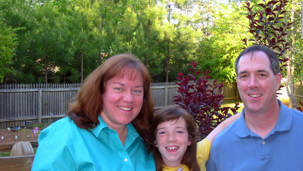 Self-described emotional eater Charmaine Jackson, here with her daughter, Caroline, and husband, Kelly, in 2004, weighed 230 pounds at the time and was on her way to a high of 260. Click through to see her weight loss transformation after she began to keep track of her eating habits through daily journaling: