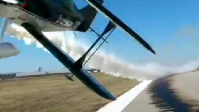 Plane barely misses hitting people