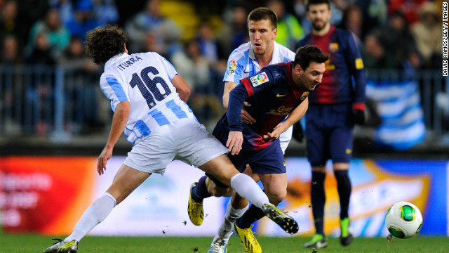 Leo Messi scored his 40th goal of the season as Barcelona defeated Malaga 4-2 in the Copa del Rey.