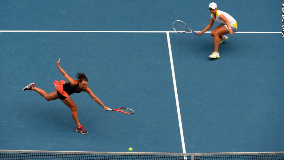 Ashley Barty of Australia, right, watches as compatriot Casey Dellacqua plays a return during their women's doubles final against Sara Errani and Roberta Vinci of Italy on day 12 of the Australian Open in Melbourne on Friday, January 25. The Italian pair beat Barty and Dellacqua 6-2, 3-6, 6-2.