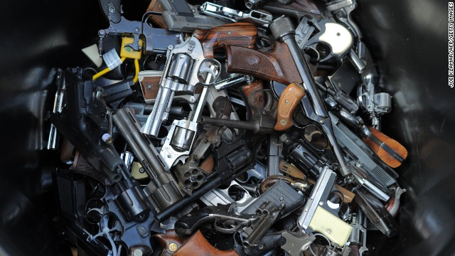 A trash bin holds handguns collected during a recent gun buyback program in Los Angeles.